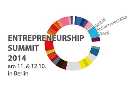 """Ein buntes Rad, vor dem """"Entrepreneurship Summit 2014 am 11. und 12.10. in Berlin"""" zu lesen ist."""