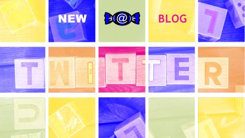 """Bunte transparente Quadrate unter denen das Wort """"Twitter"""" auf Holzklötzen zu lesen ist."""