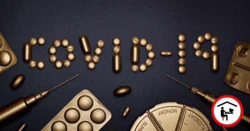 """Auf schwarzem Brund liegen goldene Spritzen und Tabletten. Einige Tabletten bilden das Wort """"Covid-19""""."""